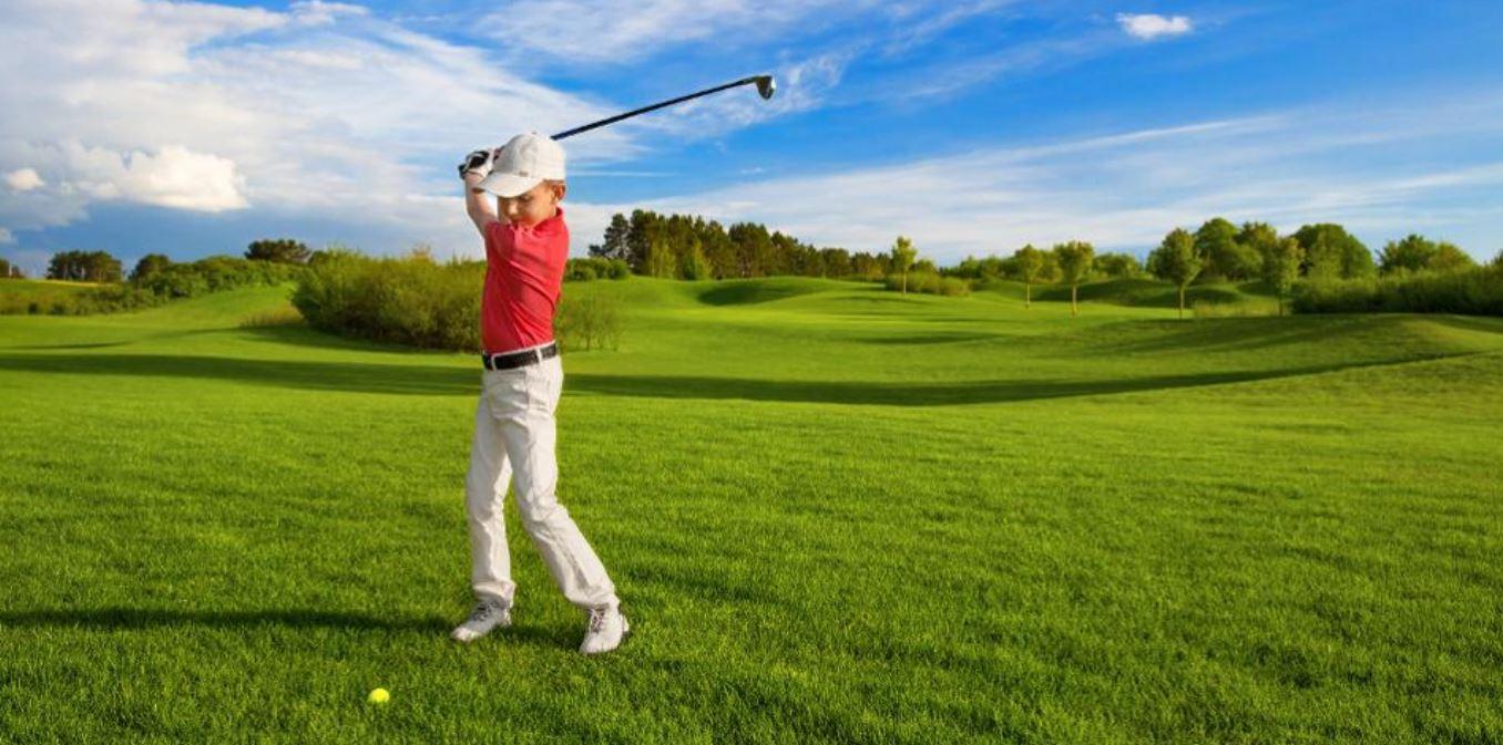 Junior Golfer Swinging
